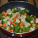 Step six: Add remaining oil to the same pan. Saute the veggies for 3 minutes.