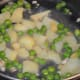 Veggies cooking in the pan.