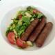 Venison sausages and salad
