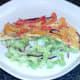 Tortilla half on salad bed
