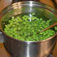 Step four: Add green peas. Keep the heat high. Stir it. Turn off the heat after two minutes.