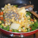Step four: Also, add pepper powder. Stir cook for 3-4 minutes or until the veggies and corn become soft yet retain some crunch.