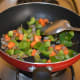 Step two: Add chopped vegetables as per instructions. Throw in some salt. Stir-cook for 3-4 minutes.