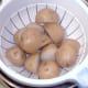 Drained boiled potatoes
