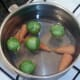 Sprouts are added to simmering carrots