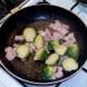 Sauteing halved sprouts and bacon