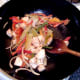 Chicken and vegetables are stir fried on a high heat