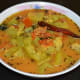 Mix the tempering with the curry. Serve cooked rice with this awesome side dish. Enjoy eating!