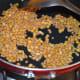 Sauté split chickpea (gram dal) and white lentil (urad dal) in oil until they get lightly golden brown.