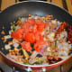 Add chopped tomatoes. Sauté until they become somewhat mushy. Now, turn off the heat.
