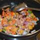 Stir-cook till tomatoes become a bit mushy.