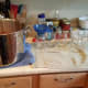 Since I cooked my salsa in my water bath canner, I have to set up a quick canning station next to my canner.