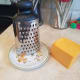 Grate your cheese.