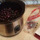 Pit all of your cherries and pop them into the crockpot.