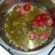 Halved tomatoes are added to garlic oil
