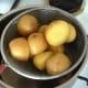 Turmeric potatoes are drained
