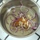 garlic and red onion is gently sauteed in curry powder and oil