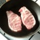 Pork fillets are seasoned and added to frying pan