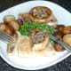Tucking in to fried pork fillets and stuffed garlic mushrooms