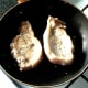 Pork fillets are turned when half way through cooking