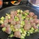 Garlic, zucchini and sausage cooking in the pan.