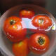 Tomatoes soaking in very hot water.