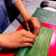 Tightly roll the banana leaf from the bottom.