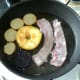 Bacon is added to frying pan