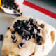 Transfer the dough onto a baking mat, combine the chocolate chips, and knead for 10 minutes.