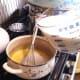 Add milk slowly, whisking at intervals. . .