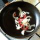 Sauteeing prepared chilli, garlic and onion