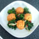 Plated spicy kale around sweet potato and carrot mash