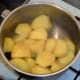 Drained potatoes are left to steam off before they are mashed
