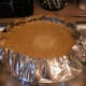 Place the filled pie pan onto a foil-lined cookie sheet to keep the oven clean.