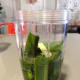 Take the pandan leaves and place them into a blender. Pour in some water and blend until fine.
