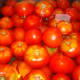 Wash the tomatoes and let them sit in a cold water bath.