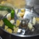 Step 2: Add chopped ginger, garlic cloves, and green chilies to a mixer or blender. Pulse 2 to 3 times to get a paste.