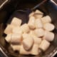 Place 15 to 20 marshmallows in a greased sauce pan. Add enough water to cover the bottom of the pan.