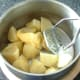 Butter is added to potatoes ready for mashing