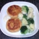 Pollack and tarragon fishcakes are served with cauliflower, broccoli and tartare sauce