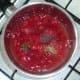 Tomatoes are seasoned in saucepan
