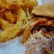 Pulled pork sandwich with onion rings