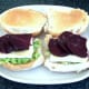 Beetroot slices are laid on corned beef and cheese and seasoned with black pepper
