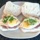Chopped coriander/cilantro garnishes eggs before rolls are closed over