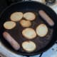 Potatoes are fried with sausages