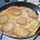 Egg is set around fried potatoes