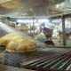 Pita bread coming down the conveyor belt