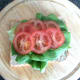 lettuce and tomato on bread base