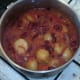 Simmering potato and red kidney bean vegetarian curry