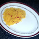 Chilli and turmeric rice is arranged on serving plate
